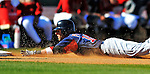 11 March 2011: Boston Red Sox second baseman Dustin Pedroia slides safely into third during a Spring Training game against the Houston Astros at Osceola County Stadium in Kissimmee, Florida. The Red Sox defeated the Astros 9-3 in Grapefruit League action. Mandatory Credit: Ed Wolfstein Photo