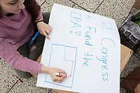 Harvard junior Lexi Smith, 20, makes a sign before the March for Science demonstration in Harvard University's Science Center Plaza in Cambridge, Massachusetts, on Sat., April 22, 2017. Smith studies Environmental Science and Public Policy and is part of a student group called the Environmental Action Committee.