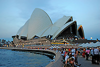 The environs of Sydney Opera House is a popular meeting place for a drink with friends & relaxation especially in the early evening when it is still warm enough to be in short sleeves. 201003284947..Copyright Image from Victor Patterson, 54 Dorchester Park, Belfast, United Kingdom, UK. Tel: +44 28 90661296. Email: victorpatterson@me.com; Back-up: victorpatterson@gmail.com..For my Terms and Conditions of Use go to www.victorpatterson.com and click on the appropriate tab.