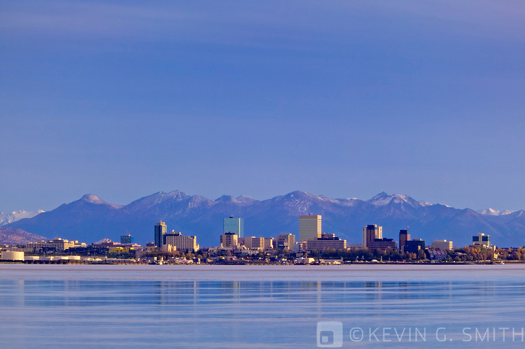 View of downtown Anchorage skyline across Knik Inlet, shot from the port at Point Mckensie. Kenai mountains in background. Fall, Anchorage Alaska.