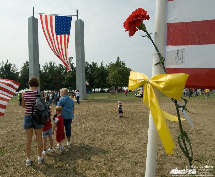 Visitors pause at the edge of a field of 3,000 flags installed in a wheat field in Maria Stein, Ohio, Monday, September 11, 2006. The display was erected to honor military, police, fire fighters, and emergency workers on the anniversary of the attacks on the World Trade Center and Pentagon in 2001.<br />