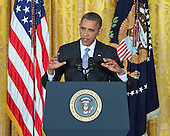 United States President Barack Obama conducts a formal press conference in the East Room of the White House in Washington, D.C. on Friday, August 9, 2013.  During the press conference, the President answered questions on NSA spying, the economy, the Olympics, and <br /> the implementation of the health care law.<br /> Credit: Ron Sachs / CNP