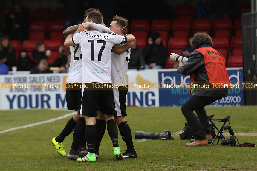 Dover players hug Ricky Miller (Far right) after scoring their third goal during Dover Athletic vs Torquay United, Vanarama National League Football at the Crabble Athletic Ground on 26th March 2016