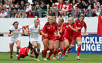 Natasha Hunt makes a break. WRWC England v Canada, World Cup Final at Stade Jean Bouin, Avenue du Général Sarrail, Paris, France, on 17th August 2014