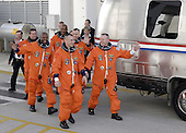 Cape Canaveral, FL - November 16, 2009 -- At the National Aeronautics and Space Administration's (NASA) Kennedy Space Center in Florida, the astronauts on the STS-129 crew, dressed in their orange launch-and-entry suits, wave to spectators as they walk out of the Operations and Checkout Building for the 15-minute ride in the Astrovan to Launch Pad 39A. From left are Mission Specialists Mike Foreman, Leland Melvin and Robert L. Satcher Jr.; Commander Charles O. Hobaugh; Mission Specialist Randy Bresnik; and Pilot Barry E. Wilmore. Liftoff is set for 2:28 p.m. EST November 16, 2009. On STS-129, the crew will deliver two Express Logistics Carriers to the International Space Station (ISS), the largest of the shuttle's cargo carriers, containing 15 spare pieces of equipment including two gyroscopes, two nitrogen tank assemblies, two pump modules, an ammonia tank assembly and a spare latching end effector for the station's robotic arm. Atlantis will return to Earth a station crew member, Nicole Stott, who has spent more than two months aboard the orbiting laboratory. STS-129 is slated to be the final space shuttle Expedition crew rotation flight. .Mandatory Credit: Kim Shiflett - NASA via CNP