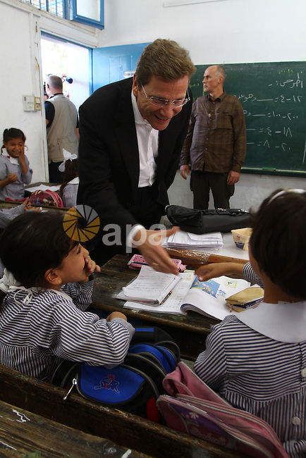 German Foreign Minister Guido Westerwelle talk with refugees students girls during his visit to Al Shatea school in the west of Gaza City on 08 November 2010. Visting German Foreign Minister Guiido Westerwelle on Monday called for the lifting of Israel's blockade on the Gaza Strip, saying that the blockade 'supports extremism and weakens the moderates . Photo by Ashraf Amra