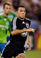 Christian Gomez. The Seattle Sounders defeated DC United, 2-1, to win the 2009 Lamr Hunt U.S. Open Cup at RFK Stadium in Washington, DC.