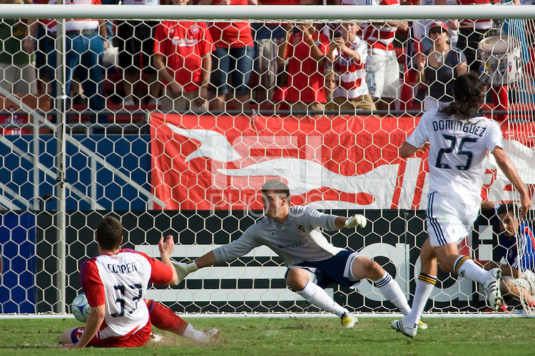 FC Dallas foward Kenny Cooper (33) slots the ball past LA Galaxy Goalkeeper Steve Cronin (1) for his second goal of the match. LA Galaxy vs FC Dallas at Pizza Hut Park Frisco, Texas July 27, 2008 Final Score 0-4.