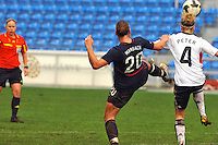 Abby Wambach tries to win the ball away from Germany's Babett Peter.  The USA captured the 2010 Algarve Cup title by defeating Germany 3-2, at Estadio Algarve on March 3, 2010.