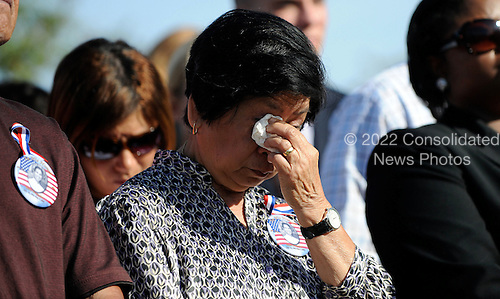 9/11 Family members and survivors react at the Pentagon Memorial during a ceremony to mark the 9th anniversary of the terrorist attacks, in Arlington, Virginia, Saturday, September 11, 2010..Credit: Olivier Douliery - Pool via CNP