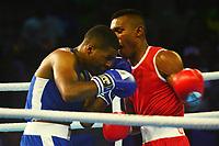 BARRANQUILLA - COLOMBIA, 25-07-2018: RANGEL M. Alexander (Colombia) vs LAMBE Andre A. (Bermudas) durante su participación en boxeo masculino categoría welter (69kg) como parte de los Juegos Centroamericanos y del Caribe Barranquilla 2018. /  RANGEL M. Alexander (Colombia) vs LAMBE Andre A. (Bermudas) during their participation in the boxing men's welter (69kg) category of the Central American and Caribbean Sports Games Barranquilla 2018. Photo: VizzorImage / Alfonso Cervantes / Cont