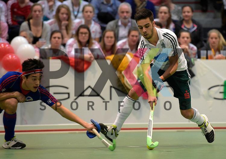 GER - Luebeck, Germany, February 06: During the 1. Bundesliga Herren indoor hockey semi final match at the Final 4 between Uhlenhorst Muelheim (white) and Mannheimer HC (blue) on February 6, 2016 at Hansehalle Luebeck in Luebeck, Germany.  Final score 2-3 (HT 7-5).  Tom Brinkmann #7 of HTC Uhlenhorst Muehlheim<br /> <br /> Foto &copy; PIX-Sportfotos *** Foto ist honorarpflichtig! *** Auf Anfrage in hoeherer Qualitaet/Aufloesung. Belegexemplar erbeten. Veroeffentlichung ausschliesslich fuer journalistisch-publizistische Zwecke. For editorial use only.