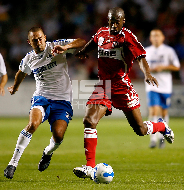 Chicago Fire forward Paulo Wanchope (12) prepares to shoot while being pressured by Kansas City Wizards midfielder Davy Arnaud (22).  The Chicago Fire defeated the Kansas City Wizards 2-0 at Toyota Park in Bridgeview, IL on August 25, 2007.