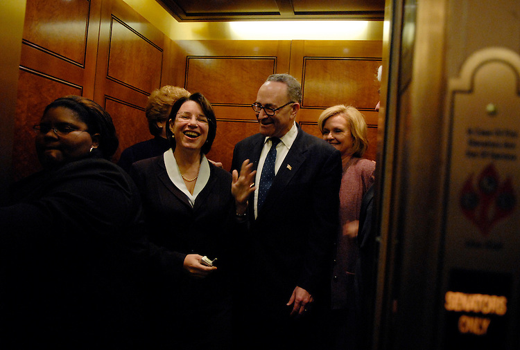 Sen. Chuck Schumer, D-N.Y., shares a laugh with Sen. Amy Klobuchar, D-Minn., before a vote.  Sen. Claire McCaskill, D-Mo., appears in the background.