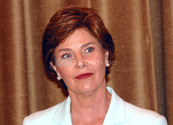 1st lady Laura Bush makes an appearance at the Beeber Middle School in Philadelphia to promote their summer reading program. June 25, 2003. © Scott Weiner /MediaPunch.