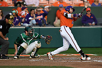 Right fielder Seth Beer (28) of the Clemson Tigers bats in a game against the William and Mary Tribe on February 16, 2018, at Doug Kingsmore Stadium in Clemson, South Carolina. The catcher is Hunter Smith. The umpire is Danny Everett. Clemson won, 5-4 in 10 innings. (Tom Priddy/Four Seam Images)