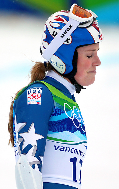 USA's Lindsey Vonn coasts across the finish line after crashing in her first run in the women's giant slalom at the XXI Olympic Winter Games Wednesday, February 24, 2010 in Whistler, British Columbia.