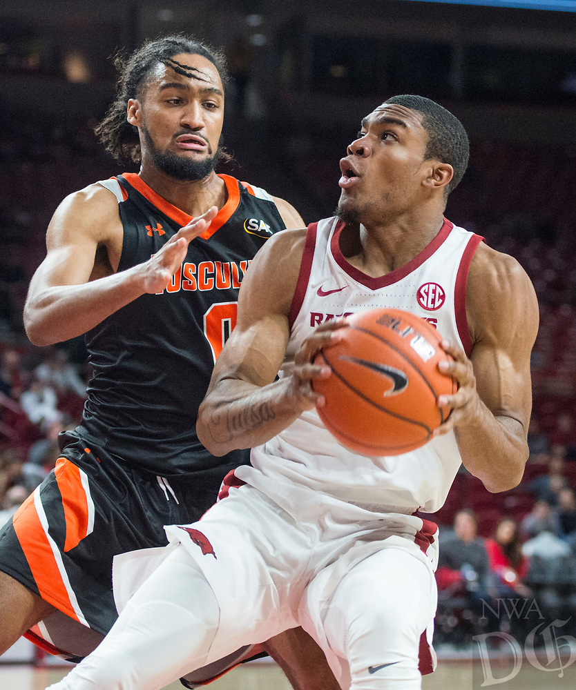 NWA Democrat-Gazette/BEN GOFF @NWABENGOFF <br /> Reggie Chaney (right) of Arkansas drives past Cam King of Tusculum in the second half Friday, Oct. 26, 2018, during an exhibition game in Bud Walton Arena in Fayetteville.