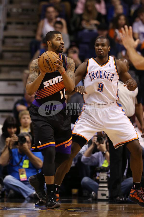 Feb. 10, 2013; Phoenix, AZ, USA: Phoenix Suns power forward Markieff Morris (left) against Oklahoma City Thunder forward Serge Ibaka at the US Airways Center. Mandatory Credit: Mark J. Rebilas-