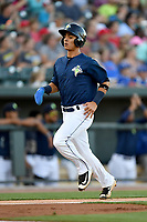 Shortstop Andres Gimenez (13) of the Columbia Fireflies trots home with a run in a game against the West Virginia Power on Friday, May 19, 2017, at Spirit Communications Park in Columbia, South Carolina. West Virginia won, 3-1. (Tom Priddy/Four Seam Images)