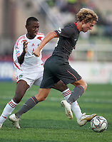 Andrew Craven controls the ball against Patience Kalumo. US Men's National Team Under 17 defeated Malawi 1-0 in the second game of the FIFA 2009 Under-17 World Cup at Sani Abacha Stadium in Kano, Nigeria on October 29, 2009.