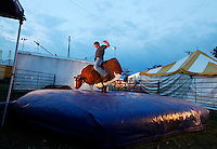 "Aaron Casey, 17, of Sikeston, Missouri, rides ""Thunder Struck - The Bull"" during the SEMO District Fair on Wednesday, Sept. 15, 2010 in Cape Girardeau, Missouri."