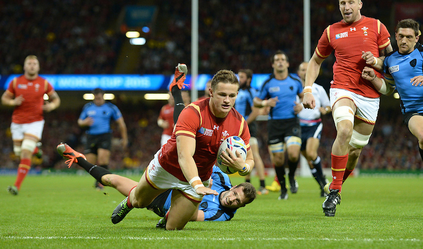 Wales' Hallam Amos scores his sides fifth try<br /> <br /> Photographer Ian Cook/CameraSport<br /> <br /> Rugby Union - 2015 Rugby World Cup - Wales v Uruguay - Sunday 20th September 2015 - Millennium Stadium - Cardiff<br /> <br /> &copy; CameraSport - 43 Linden Ave. Countesthorpe. Leicester. England. LE8 5PG - Tel: +44 (0) 116 277 4147 - admin@camerasport.com - www.camerasport.com