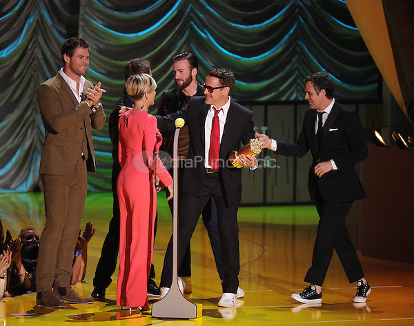 LOS ANGELES, CA - APRIL 12: Scarlett Johansson, Jeremy Renner, Chris Evans, Chris Hemsworth, and  Mark Ruffalo present the MTV Generation Award to Robert Downey Jr. on the 2015 MTV Movie Awards at the Nokia Theatre LA Live on April 12, 2015 in Los Angeles, California. Credit: PGFM/MediaPunch