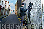 Tralee Artist Mike O'Donnell working on a mural in Tralee.