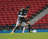 Graham Carey takes hold of Lassad Nouioui in the St Mirren v Celtic Scottish Communities League Cup Semi Final match played at Hampden Park, Glasgow on 27.1.13.