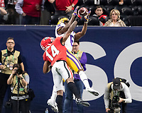 ATLANTA, GA - DECEMBER 7: DJ Daniel #14 of the Georgia Bulldogs defends a pass against Terrace Marshall Jr. #6 of the LSU Tigers during a game between Georgia Bulldogs and LSU Tigers at Mercedes Benz Stadium on December 7, 2019 in Atlanta, Georgia.
