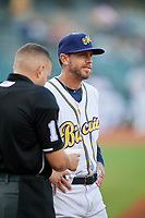 Montgomery Biscuits manager Brady Williams (22) meets with home plate umpire Jonathan Parra and the rest of the umpiring crew before a game against the Mississippi Braves on April 24, 2017 at Montgomery Riverwalk Stadium in Montgomery, Alabama.  Montgomery defeated Mississippi 3-2.  (Mike Janes/Four Seam Images)