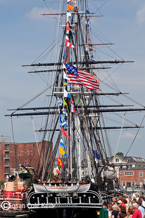 "Tugboats ""Harold A Reinauer"" and ""Jason Reinauer"" assist the USS Constitution on her annual Turnaround Cruise on July 4th in Boston Harbor, Boston, MA, USA"