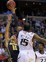 Michael Dixon of the Tigers puts up a shot over the defense of Bearcats' Darnell Wilks. Cincinnati defeated Missouri 78-63 during the NCAA tournament at the Verizon Center in Washington, D.C. on Thursday, March 17, 2011. Alan P. Santos/DC Sports Box