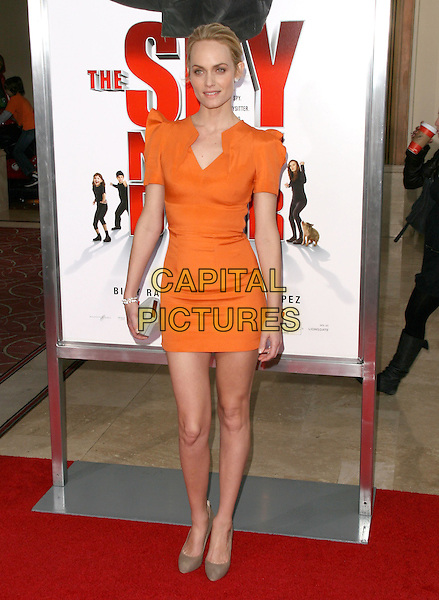 "AMBER VALLETTA .at  the World Premiere of ""The Spy Next Door"" held The Grove in Los Angeles, California, USA, January 9th, 2010..full length orange dress shoulder pads mini clutch bag beige suede brown shoes.CAP/RKE/DVS.©DVS/RockinExposures/Capital Pictures"