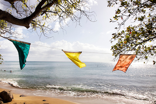 Flags on the beach at Balneario de Rincón in Rincón, Puerto Rico on 1st January 2012.