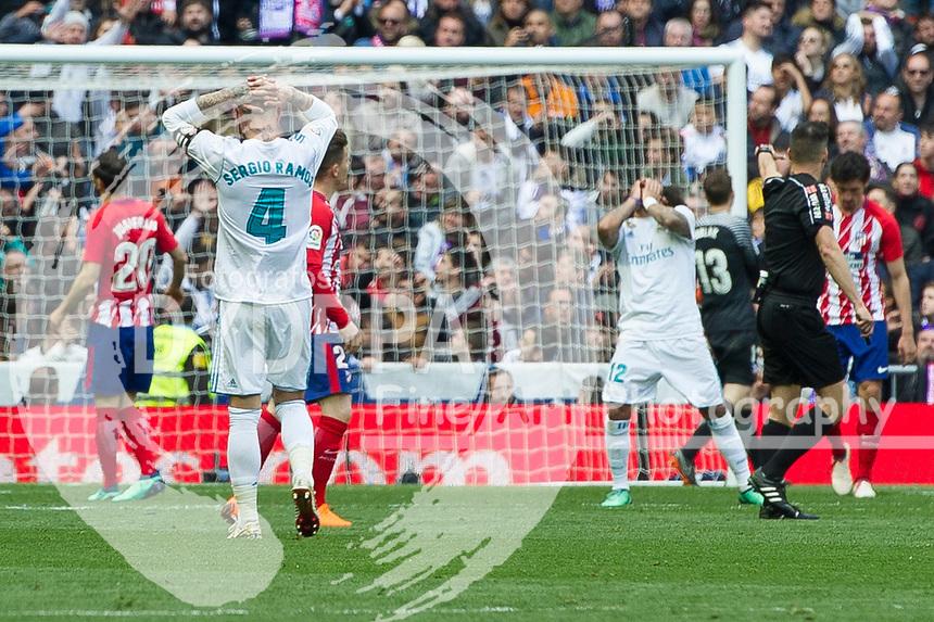 Real Madrid's Spanish defender Sergio Ramos<br /> Spanish league football match Real Madrid vs Atletico de Madrid at the Santiago Bernabeu stadium in Madrid on April 8, 2018.