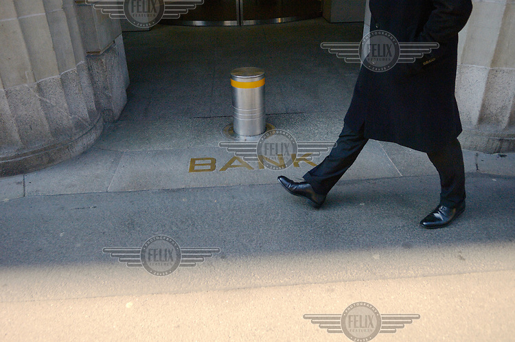 A man walks past an entrance to a branch of UBS on Bahnhofstrasse in Zurich. The Swiss banking industry holds an estimated 4,000 billion Swiss Francs (USD 4,240 billion) in assets, more than half of it foreign, including CHF 880 billion in undeclared European assets alone, benefiting from the country's famous banking secrecy laws.