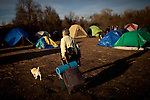 A camper leaves the SafeGround camp in Sacramento, Calif., January 14, 2011.