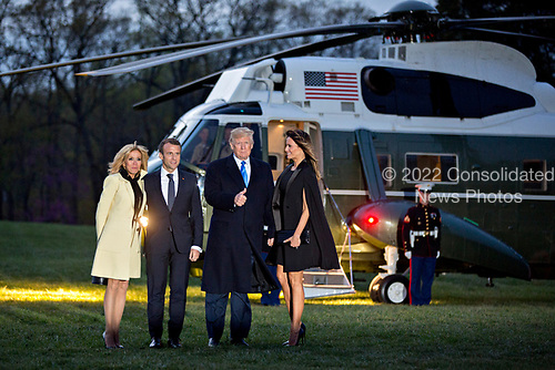U.S. First Lady Melania Trump, from right, U.S. President Donald Trump, Emmanuel Macron, France's president, and Brigitte Macron, France's first lady, stand for photographers in front of Marine One after a dinner at the Mount Vernon estate of first U.S. President George Washington in Mount Vernon, Virginia, U.S., on Monday, April 23, 2018.  As Macron arrives for the first state visit of Trump's presidency, the U.S. leader is threatening to upend the global trading system with tariffs on China, maybe Europe too. <br /> Credit: Andrew Harrer / Pool via CNP