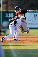 Third baseman Jake Beaver (11) of the University of South Carolina Upstate Spartans applies the tag late as Ryan Brown (10) of the College of Charleston Cougars is safe at their on Tuesday, March 31, 2015, at Cleveland S. Harley Park in Spartanburg, South Carolina. Charleston won, 10-0. (Tom Priddy/Four Seam Images)