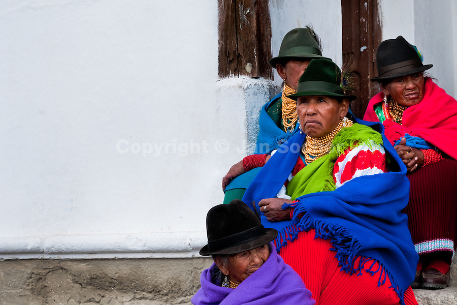 """Old women, wearing colorful clothes, watch a procession during the Inti Raymi festival in Pichincha province, Ecuador, 26 June 2010. Inti Raymi, """"Festival of the Sun"""" in Quechua language, is an ancient spiritual ceremony held in the Indian regions of the Andes, mainly in Ecuador and Peru. The lively celebration, set by the winter solstice, goes on for various days. The highland Indians, wearing beautiful costumes, dance, drink and sing with no rest. Colorful processions in honor of the God Inti (Sun) pass through the mountain villages giving thanks for the harvest and expressing their deep relation to the Mother Earth (Pachamama)."""