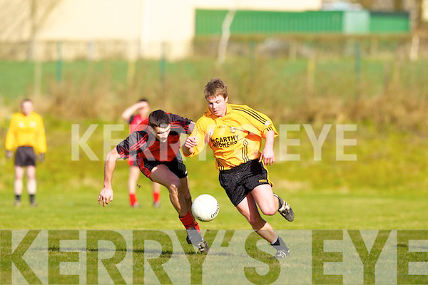 David Sheehy of Listowel Emmets races against Tarbert's Shane Enright for the loose ball in the The Bernard O'Callaghan Memorial Senior Football Championship Final replay last Sunday afternoon in Con Brosnan Park, Moyvane