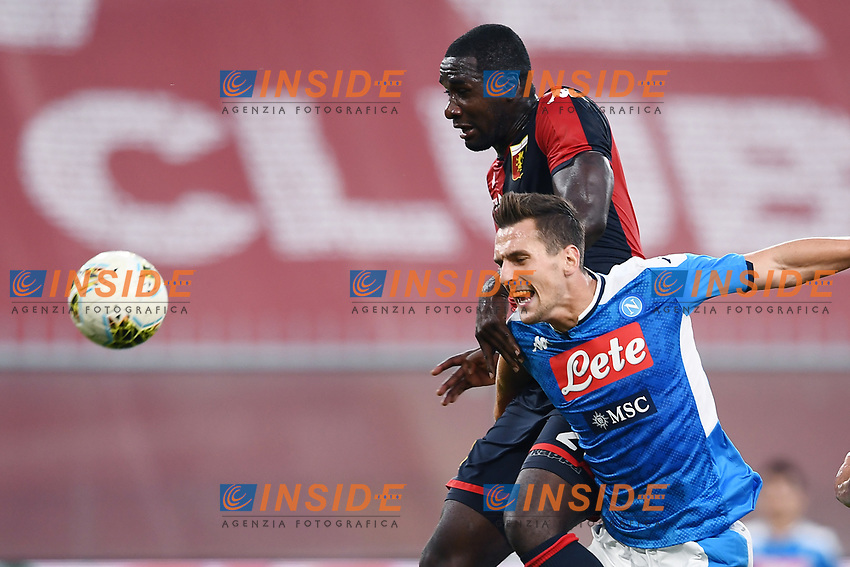 Cristian Zapata of Genoa and Arkadiusz Milik of SSC Napoli compete for the ball during the Serie A football match between Genoa CFC and SSC Napoli stadio Marassi in Genova ( Italy ), July 08th, 2020. Play resumes behind closed doors following the outbreak of the coronavirus disease. <br /> Photo Matteo Gribaudi / Image / Insidefoto