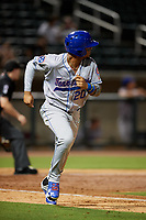 Tennessee Smokies right fielder Eddy Martinez (20) runs to first base during a game against the Birmingham Barons on August 16, 2018 at Regions FIeld in Birmingham, Alabama.  Tennessee defeated Birmingham 11-1.  (Mike Janes/Four Seam Images)