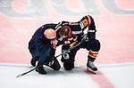 Stockholm 2014-03-27 Ishockey Kvalserien Djurg&aring;rdens IF - R&ouml;gle BK :  <br /> Djurg&aring;rdens Dustin Johner p&aring; kn&auml; p&aring; isen efter en situation d&auml;r R&ouml;gles Daniel Zaar blir utvisad i den andra perioden<br /> (Foto: Kenta J&ouml;nsson) Nyckelord:  DIF Djurg&aring;rden R&ouml;gle RBK Hovet skada skadan ont sm&auml;rta injury pain utvisning utvisad utvisas