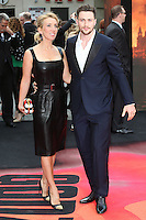 Aaron Taylor Johnson and Sam Taylor Wood arriving for the European premiere of Godzilla, at Odeon Leicester Square, London. 11/05/2014 Picture by: Alexandra Glen / Featureflash