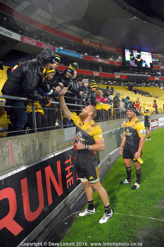 Brad Shields minagles with fans after the Super Rugby quarterfinal match between the Hurricanes and Sharks at Westpac Stadium, Wellington, New Zealand on Saturday, 23 July 2016. Photo: Dave Lintott / lintottphoto.co.nz