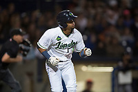 Hillsboro Hops center fielder Jorge Perez (16) runs down the first base line during a Northwest League game against the Salem-Keizer Volcanoes at Ron Tonkin Field on September 1, 2018 in Hillsboro, Oregon. The Salem-Keizer Volcanoes defeated the Hillsboro Hops by a score of 3-1. (Zachary Lucy/Four Seam Images)