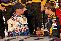 Nov 12, 2005; Phoenix, Ariz, USA;  Nascar driver Carl Edwards is congratulated by Clint Bowyer after winning the Busch Series Arizona 200 at Phoenix International Raceway. Mandatory Credit: Photo By Mark J. Rebilas